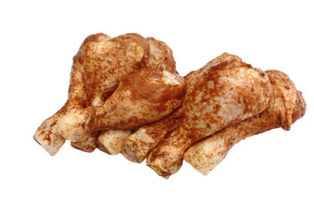 at close quarters: Uncooked Dry Rubbed Chicken Legs Isolated On White Background, Close Up, Top View