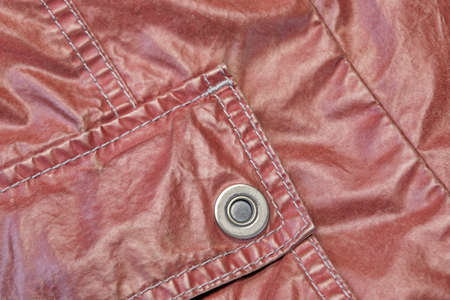 sewn up: Red Modern Vintage Shabby Leather Jacket Fragment With Patch Pocket, Close Up, Background With Copy Space Stock Photo