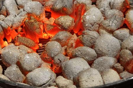briquettes: Glowing Hot Charcoal Briquettes Background Texture, Top View, Close-up Stock Photo