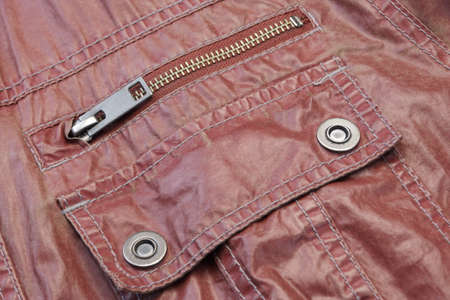 metal fastener: Zippered Red Leather Pocket With Metal Fastener, Close-up