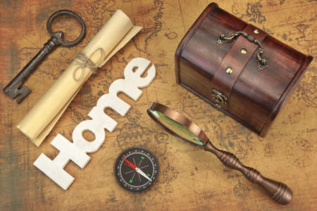 paper roll: Travel Concept, Still Life Objects Key, Paper Roll, Home Sign, Magnifier, Compass And Key On Vintage Old Map Background Stock Photo