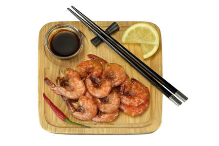 king size: Grilled Red King Size Shrimps Or Prawns With Sauce, Chili Pepper and Lemon, Served With Wood Chopsticks On Wood Board  Isolated On White Background, Close Up, Top View Stock Photo