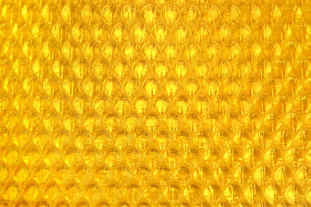 polyethylene film: Amber Bubble Paper Or Air Cushion Packing Film Abstract Horizontal Texture For Creative Art Work Background, Close Up, Top View, Copy Space