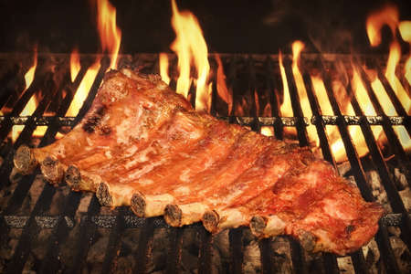 back rub: BBQ Roasted Pork Baby Back Or Spareribs On The Hot Charcoal Grill With Flames, Closeup Stock Photo