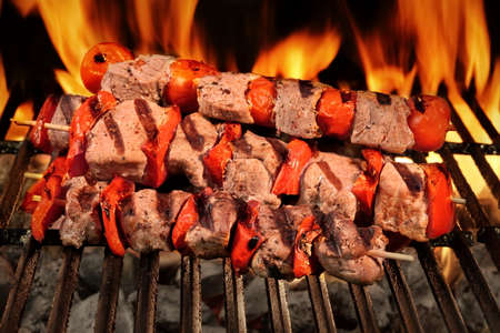kebob: Many Shish Kebab From Different Meat With Pepper And Tomato On The Hot Charcoal BBQ Grill With Bright Flames On The Black Background, Cookout Concept, Close Up, Top View