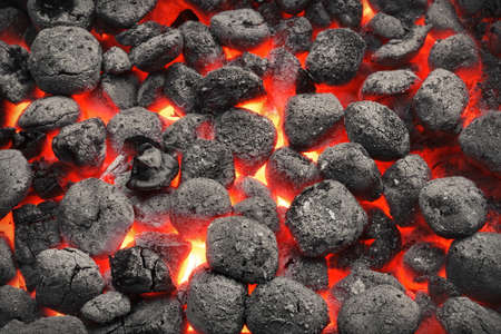 BBQ Grill Pit With Glowing And Flaming Hot Charcoal Briquettes, Food Background Or Texture, Close-Up, Top View