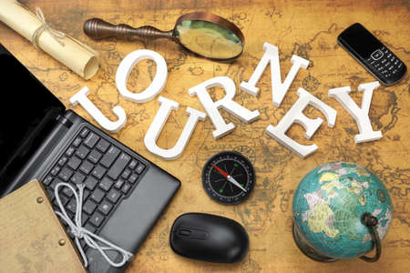 gsm: Wooden Sign Journey, Laptop With Blank Display, Computer Mouse, Vintage Globe And Retro Magnifier, Modern Compass, GSM Phone And Letter On The Old Map, Flat Lay, Overhead View Stock Photo