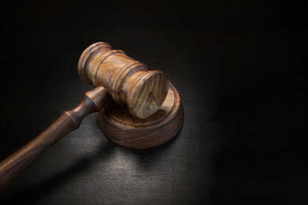 auctioneer: Judges Or Auctioneer Gavel On Black Wood Grunge Background, Top View, Close-Up.