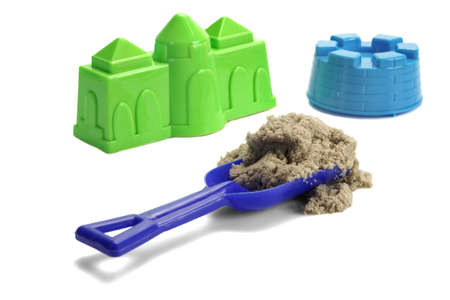kinetic: Blue Plastic Shovel With Sand Or Kinetic Sand On It And Plastic Molds Around Isolated On White Background