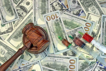 negligence: Wood Judges Gavel And Medical Syringe With Injection On The Dollar Cash Background