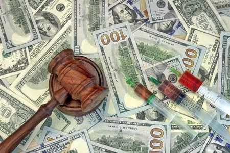 parole: Wood Judges Gavel And Medical Syringe With Injection On The Dollar Cash Background