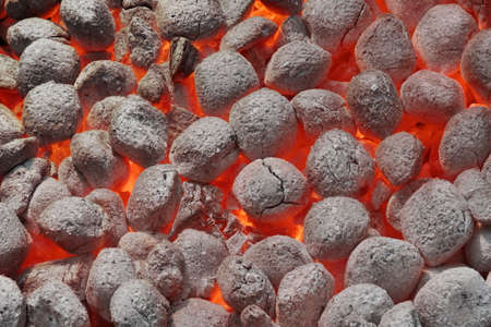 briquettes: BBQ Grill Pit With Glowing And Flaming Hot Charcoal Briquettes, Food Background Or Texture, Close-Up, Top View