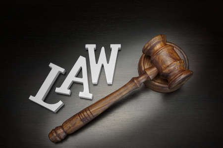 lawful: Top View Of Judges Gavel And White Sign Law On The Black Wood Background
