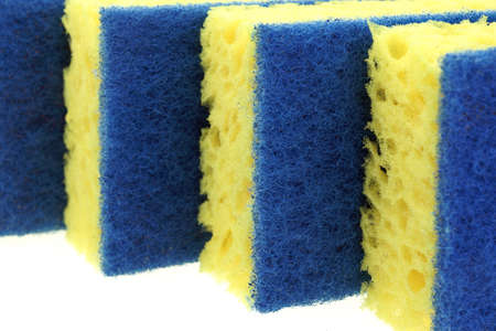 Four New Absorbent Yellow Sponge With Blue Hardwearing Fiber Scourer Isolated On White Background, Close Up