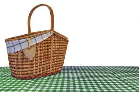 pic nic: Picnic Basket On The Green Checkered Tablecloth Isolated On White Background