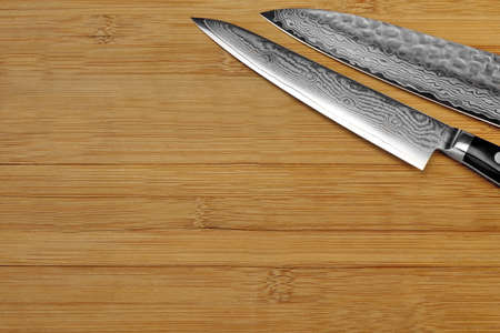 cuchillo de cocina: Single Japanese Professonal Long Kitchen Knife On The Bamboo Empty Cutting Board, Top View, Close Up, Copy Space Foto de archivo