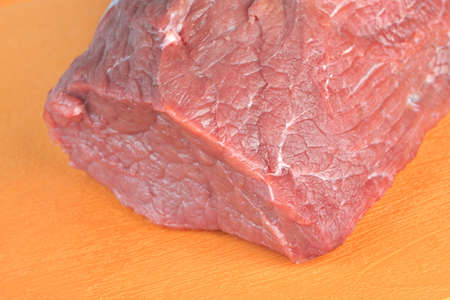 tenderloin: Uncooked Beef Tenderloin Large Meat Cut On The Orange Plastic  Cutting Board, Isolated Background, Close Up, Top View. Raw Veal Meat Chop.