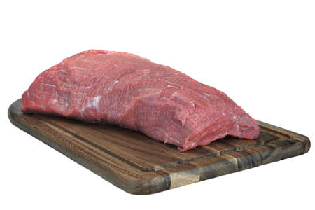 tenderloin: Raw Beef Tenderloin Large Meat Cut On The Wooden Cutting Board, White Isolated Background, Close Up, Top View. Raw Veal Meat Chop