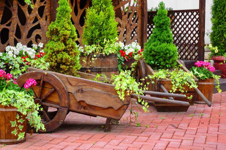 Decorative Patio At The Backyard Garden Wit Wooden Decoration And Flowers