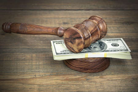 bidding: Judges or Auctioneer Gavel, Soundboard And Bundle Of Dollar Cash On The Rough Wooden Textured Table Background. Concept For Corruption, Bankruptcy Court, Bail, Crime, Bribing, Fraud, Auction Bidding.