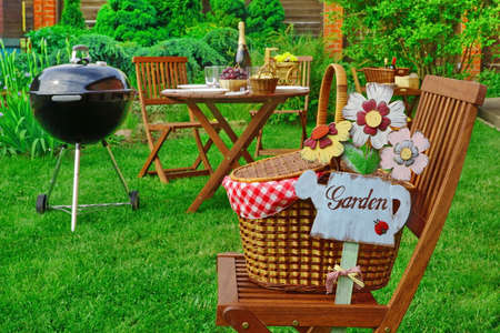 Close Up Of Chair With Hamper And Sign Garden, Family Home Party Scene,
