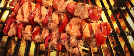 barbequing: Homemade Kebabs From Different Meat Mixed With Pepper And Tomato On The Hot Charcoal BBQ Gril