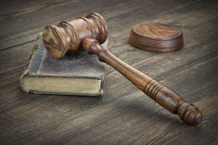 fair trial: Old Vintage Law Book And Judges Gavel Or Hummer On Top On The Wooden Table In Law Office Or Courtroom, Law Education Concept, Close Up Stock Photo