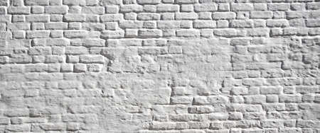 whitewash: White plastered brick wall. Background and texture with space for text or image.