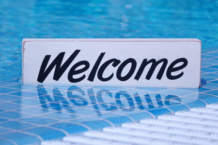 Welcome Sign And Empty Swimming Pool Surface In The Background, Pool Party Invitation Concept
