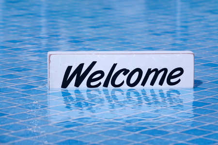 no swimming sign: Welcome Sign And Empty Swimming Pool Surface In The Background, Pool Party Invitation Concept