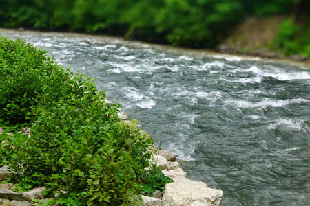 brooks camp: Flow Mountain River In Rocky Shores Landscape,  White Water Rafting Route