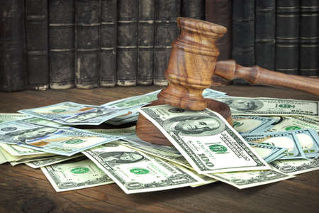 auction win: Auction Or Trial Concept With Auctioneers Or Judges Gavel And Scattered Money Heap On Wooden Table, Close Up,