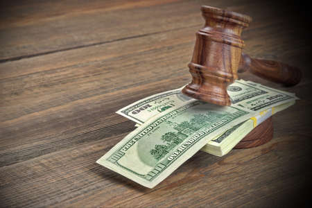 auctioneer: Judges or Auctioneer Gavel, Soundboard And Bundle Of Dollar Cash On The Rough Wooden Textured Table Background. Concept For Corruption, Bankruptcy Court, Bail, Crime, Bribing, Fraud, Auction Bidding.