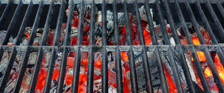 griller: Hot Barbecue Cast Iron Grill With Glowing Charcoal Background