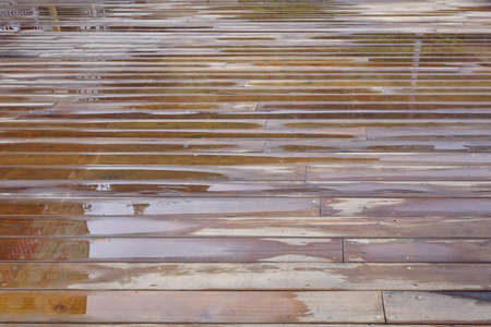 rain wet: Wet Patio Flooring Background After Rain In Perspective Top View Stock Photo