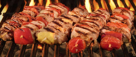 Homemade Kebabs From Different Meat Mixed With Pepper And Tomato On The Hot Charcoal BBQ Gril
