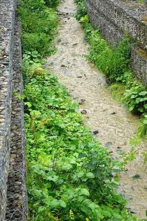 gabion mesh: Streambank And Shoreline  Stabilization Through The Use Gabions, Mountain Stream Landscape Stock Photo
