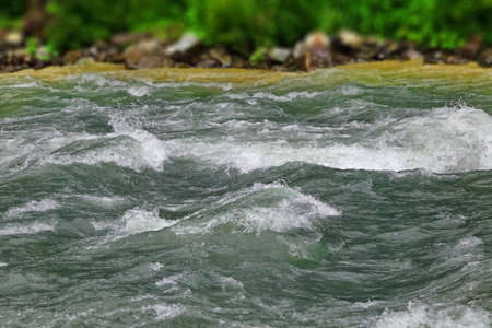 Flow Mountain River In Rocky Shores Landscape,  White Water Rafting Route
