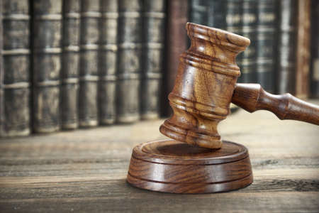 bidding: Auctioneer Or Judges Hammer or Gavel Among Old Vintage Books On Wooden Bench Or Table, Trial Concept, Auction Concept, Bidding Concept, Close Up