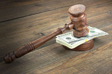 confiscation: Judges or Auctioneer Gavel, Soundboard And Bundle Of Dollar Cash On The Rough Wooden Textured Table Background. Concept For Corruption, Bankruptcy Court, Bail, Crime, Bribing, Fraud, Auction Bidding.