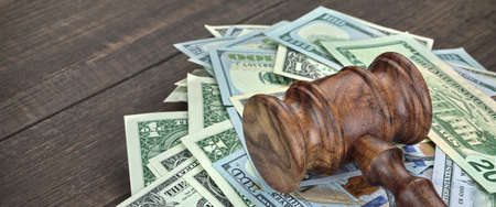 alimony: Stack Of Dollar Banknotes With Judges Or Auctioneers Gavel Or Hammer, Trial Or Tribunal Concept, Auction Concept, Close Up