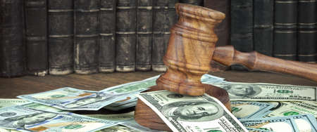 confiscation: Auction Or Trial Concept With Auctioneers Or Judges Gavel And Scattered Money Heap On Wooden Table, Close Up,