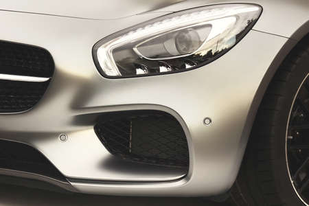 The Hood Of Modern German Sport Or Business Car With A Matte Silver Metallic Coating, Black Coolant Radiator Grille, Xenon Head light, Bumper With Park