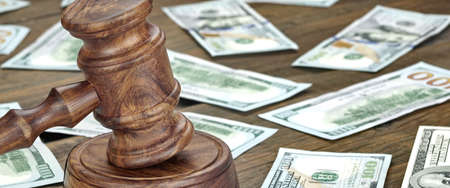 white collar crime: Financial Crime or Fraud or Auction Concept Image With Judges Gavel or Auction Hammer And Money Stack On The Background, Close Up
