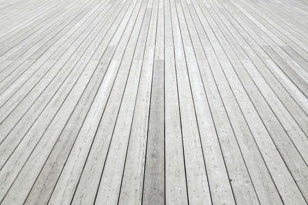 Perspective View Of Outdoor Shabby White Wood Decking Background Texture. White Wooden Plank Panel Top View. Rustic Hardwood Surface Stock Photo