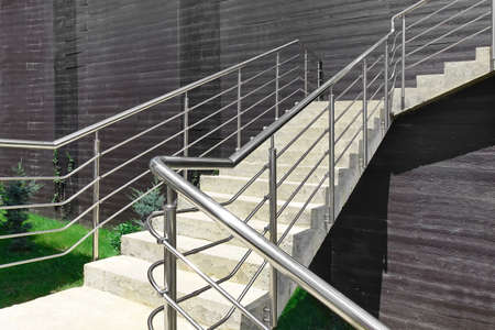 Outdoor Concrete Staircase With Stainless Steel Handrail, Front View, Close Up