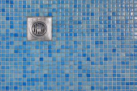 outflow: Poolside Outdoor Shower Cabin Blue Tiled Floor  With Grate Of Outflow, Top View, Copy Space