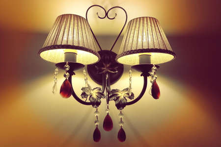 plafond: Indoor Interior Double Scone With  Hanging Decorative Crystal And Cozy Comfortable Yellow Light, Close Up