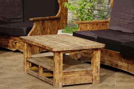 massy: Solid Natural Wood Outdoor Handmade Table And Couch On The Terrace At Summertime