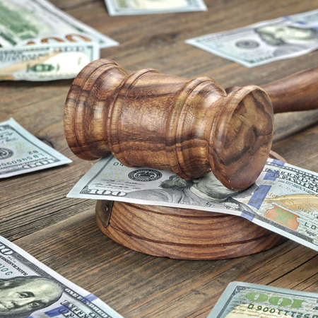 lien: Judges or Auctioneers Gavel Or Hammer And Big Money Stack On Wooden Bench Or Wooden Table Background, Concept For Financial Crime, Close Up